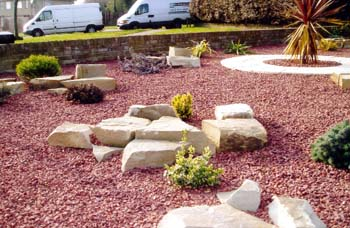 Boulevard landscapes our work water features for Red stone landscape rock